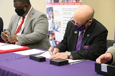 BRCC_LSUA 3: BRCC Chancellor Dr. Willie E. Smith and LSUA Chancellor Dr. Paul Coreil sign the  2+2 Agreement, aligning resources between the BRCC and LSUA Business Departments.